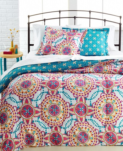 Good This reversible Ainsley Comforter Set is available in full queen or king It features elaborate medallion designs with a white background and accents of