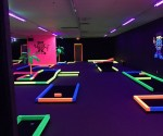Groupon: Glow-In-The-Dark Mini Golf for Two, Four, or Six at Glow in One Mini Golf (Up to 60% Off)
